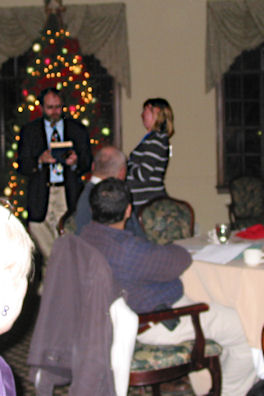 Jeff Cornelius receives gavel and book from Shelley Minteer