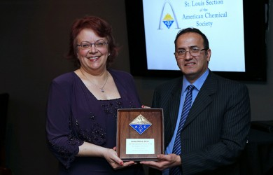Leah O'Brien receives Distinguished Service Award from Ziad Ramadan