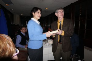 The book-and-gavel pass signifies the start of a new Section year (Pegah, left; Jim, right).