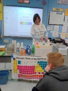 Amy Kerkenmeyer doing the pH testing during the Chemistry is pHun program for eighth graders