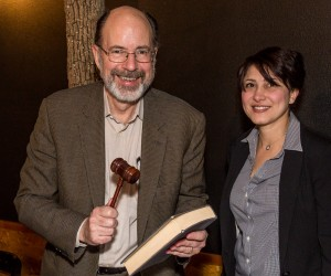 Joe Ackerman receives book and gavel, the trappings of the Chair, from Pegah Jalili