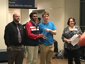 Winners Vignesh Janardhanam and Alexander Curylo flanked by their teacher Justin Little (far left) and titrator-in-chief Leah O'Brien (far right)