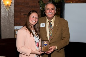 Bill Doub receives the Distinguished Service Award from Chair-Elect Natalie LaFranzo